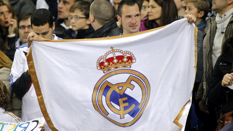 A fan holding a Real Madrid flag