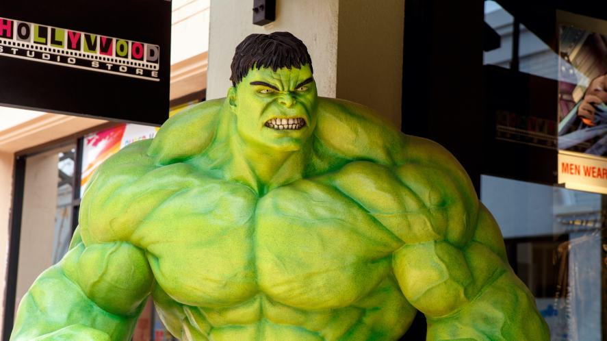 A model of the Hulk standing outside of a shop