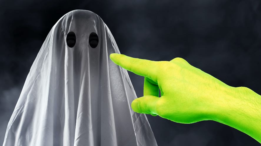 A green finger pointing at a ghost