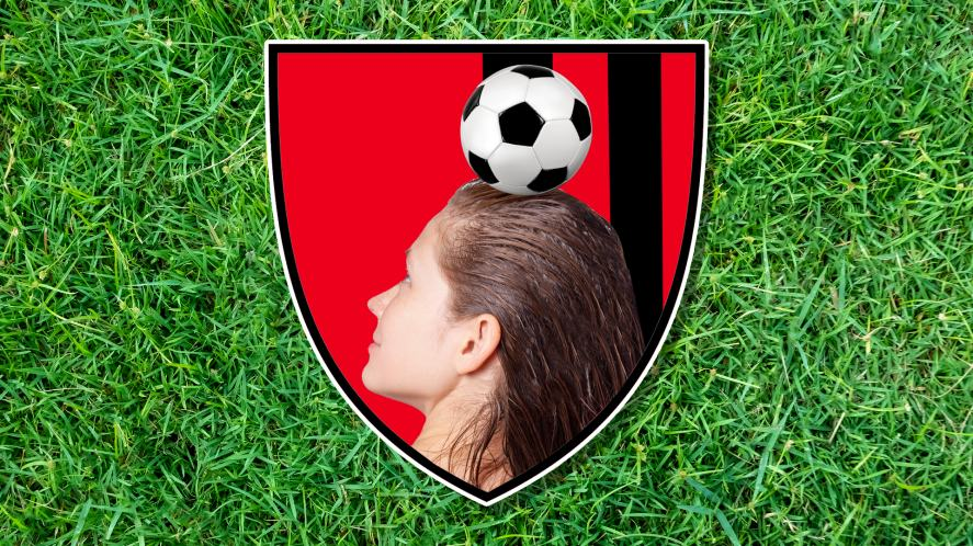 A woman with long wet hair heads a football