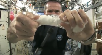 Wringing a wet cloth in space