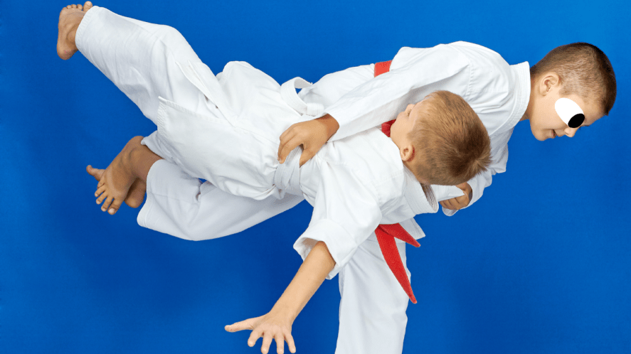 Two children practising Judo