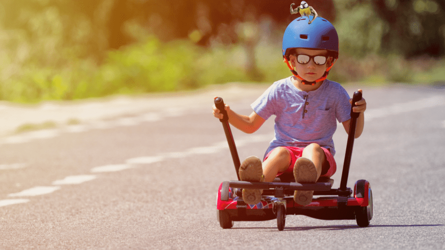 A young chap tearing along on some sort of cool kart