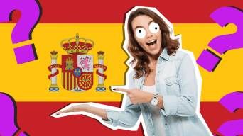 Woman smiling in front of Spain flag