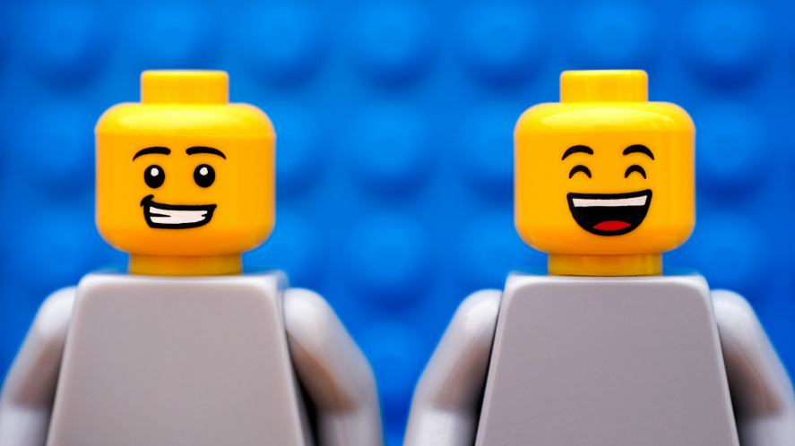 Two smiling LEGO characters