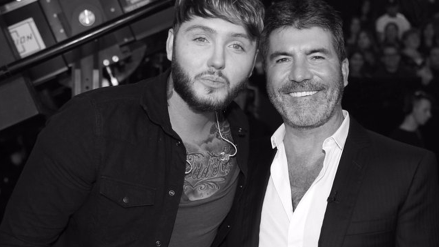 Simon Cowell and friend
