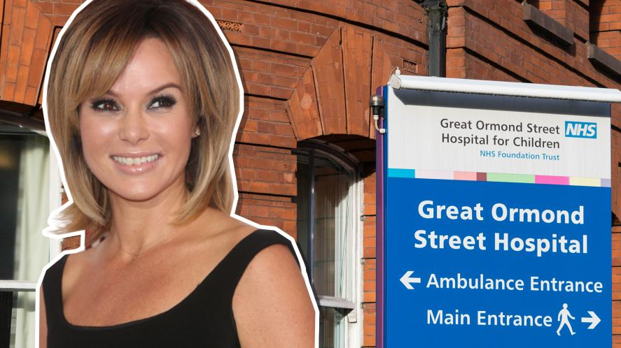 Amanda Holden and a sign for Great Ormond Street Hospital