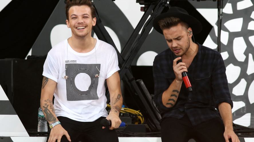Liam Payne and Louis Tomlinson of One Direction perform on 'Good Morning America' in Central Park in New York City