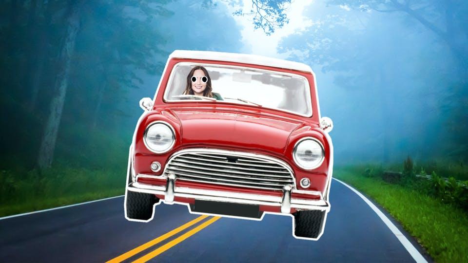 A woman in a Mini car