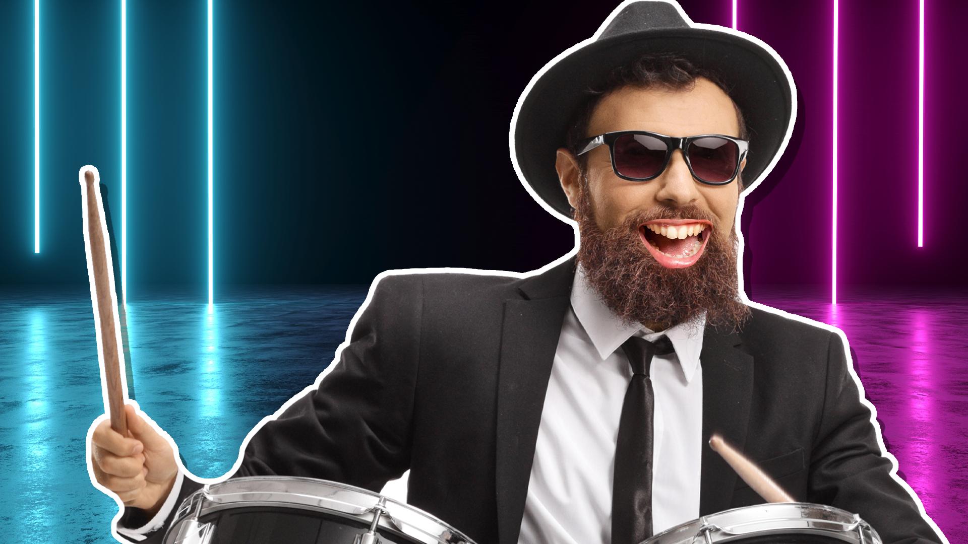A drummer with a big bushy beard