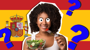 Woman eating in front of Spanish flag