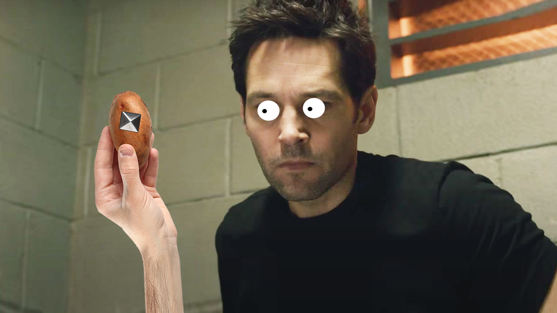 Paul Rudd holding a spud with a stud in it