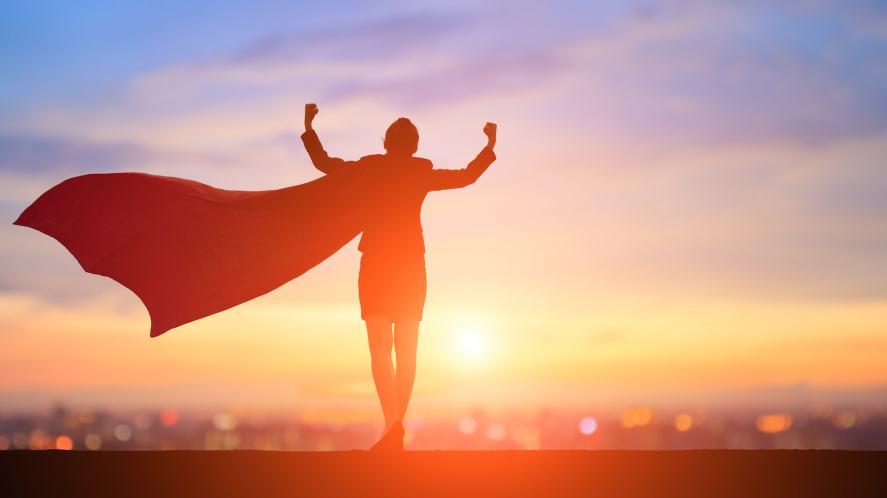 A silhouette of a superhero
