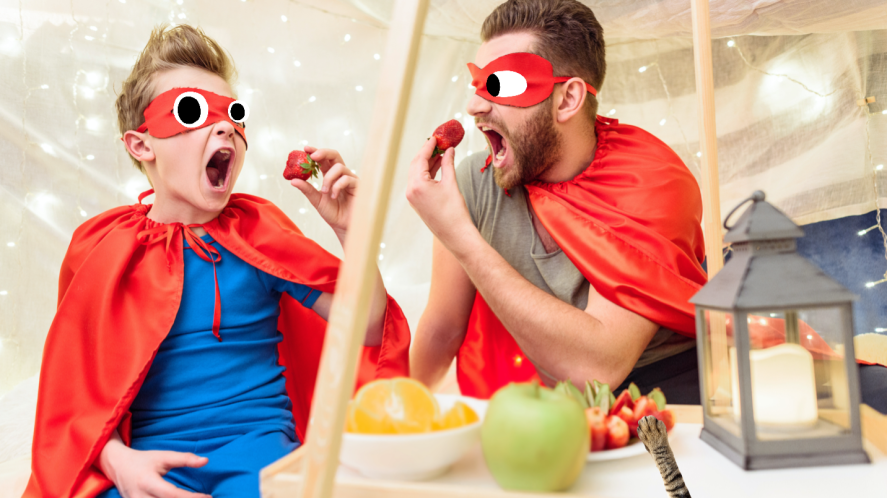 Two superheroes enjoy a snack