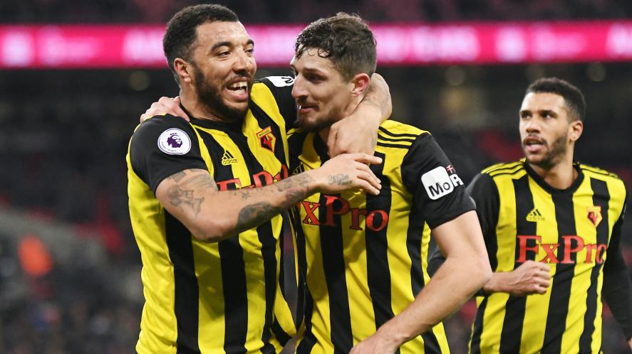 Craig Cathcart celebrates with Troy Deeney after scoring a goal during the 2018/19 Premier League game between Tottenham Hotspur and Watford FC at Wembley Stadium.