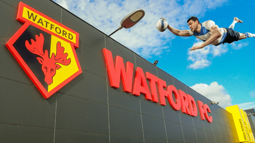 A rugby player diving into Watford's football ground