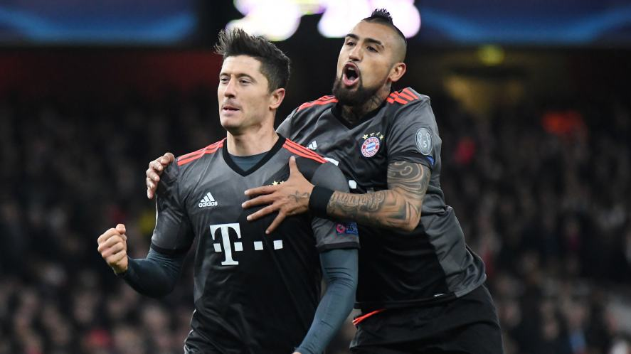 Robert Lewandowski and Arturo Vidal celebrate after a goal during the UEFA Champions League Round of 16 game between Arsenal FC and Bayern Munich at Emirates Stadium