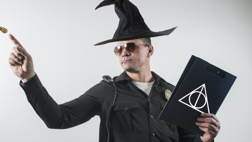 A police officer dressed as a wizard