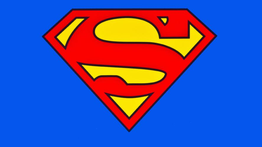 A stock image of a Superman logo on a blue background