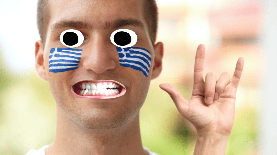 A man with Greek flags painted on his cheeks