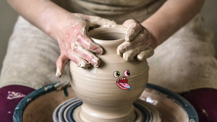 A potter working on a vase