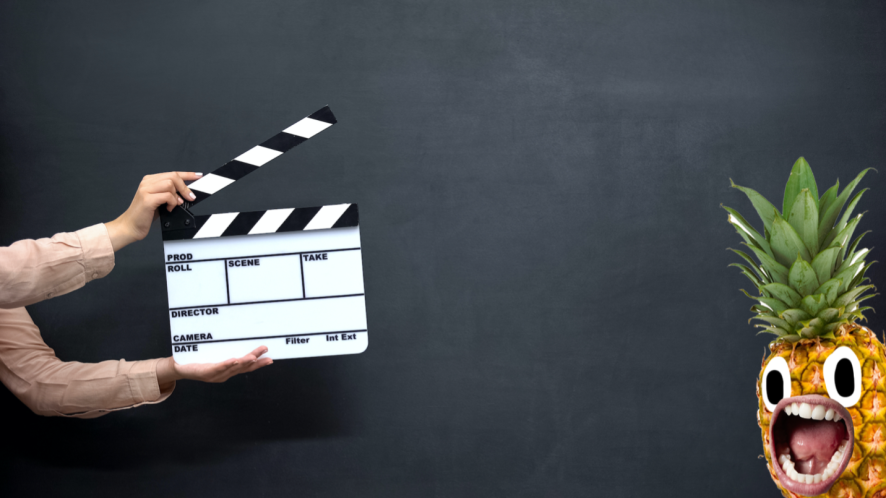 Hands using a clapperboard against dark background