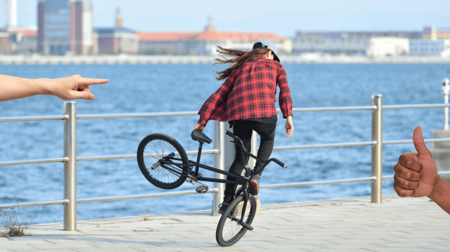 A person doing stunts on a BMX