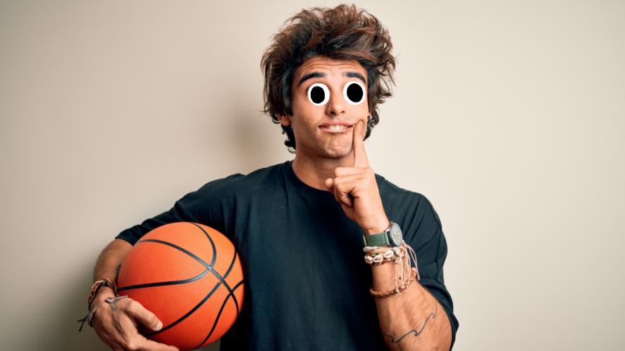 Wondering guy holding a basketball