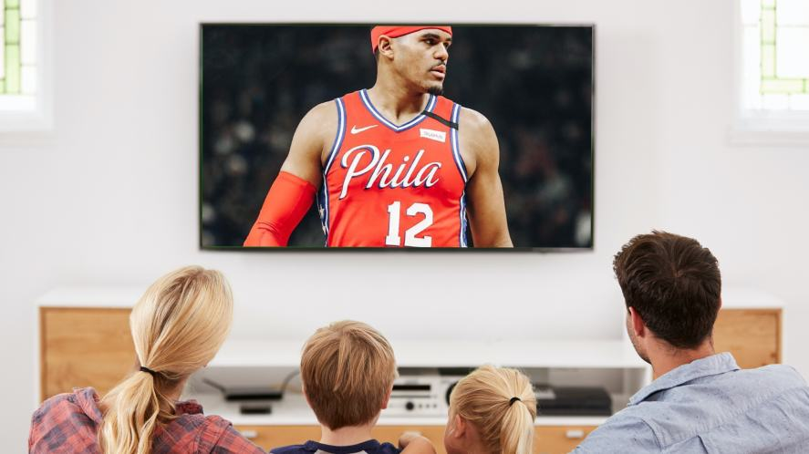 A family watching a basketball game on TV