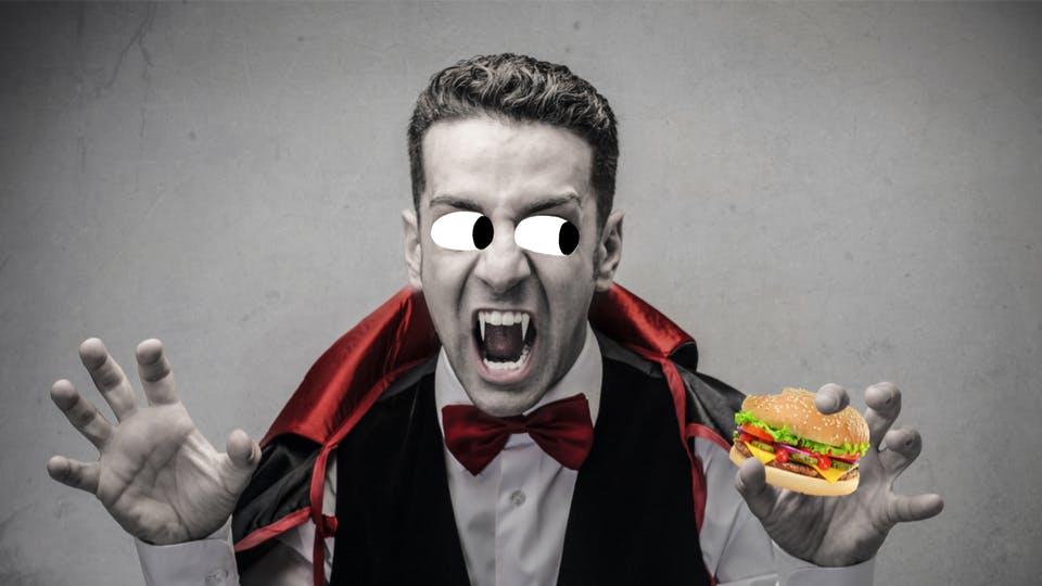 Dracula eating a burger