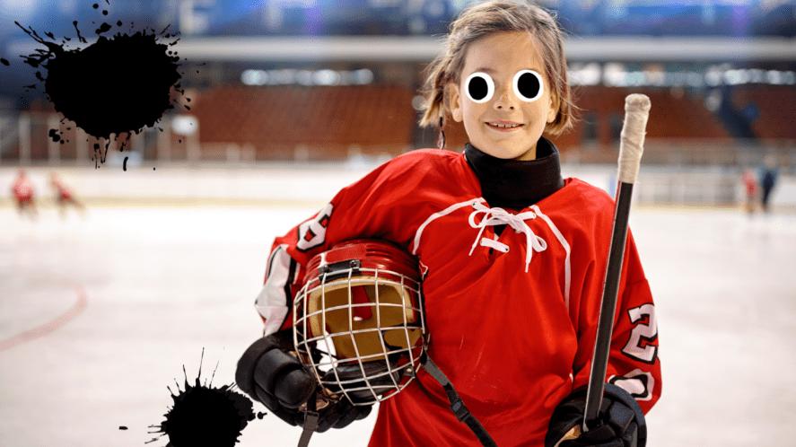 Girl in hockey uniform on ice rink