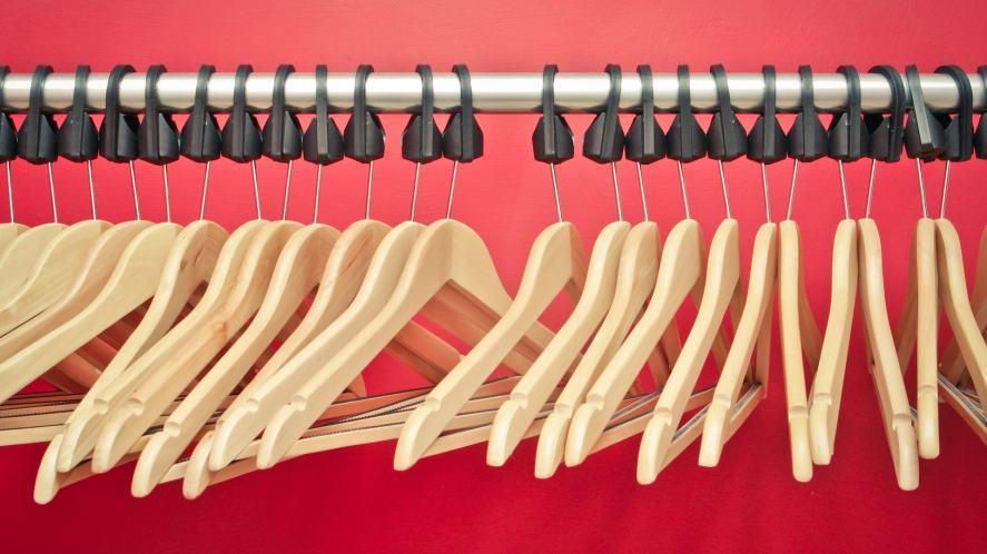A clothing rail full of empty hangers