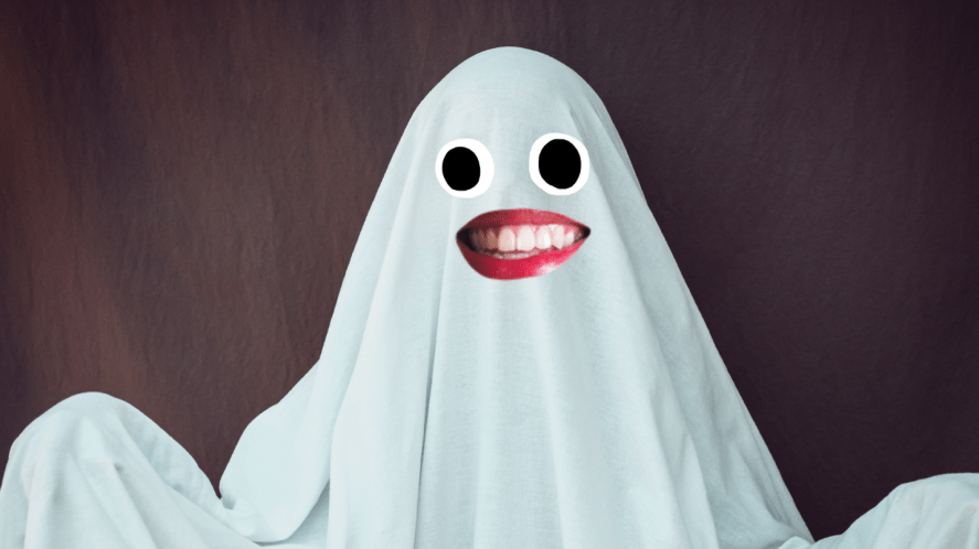 Ghost made of sheet on a black background