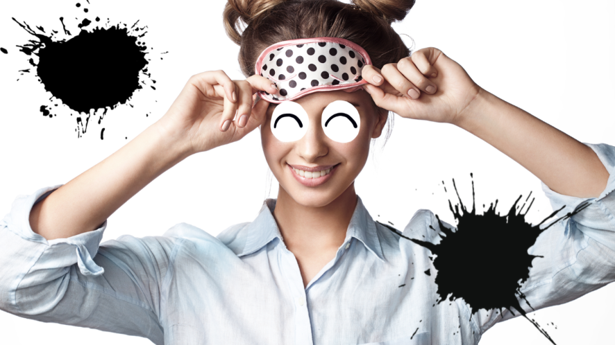 Woman in sleep mask rubbing eyes on white background