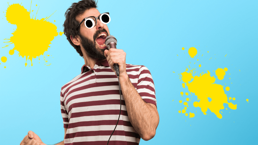 Man singing into mic on blue background
