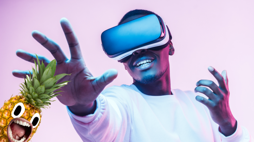 A man in VR goggles reaching out for a pineapple