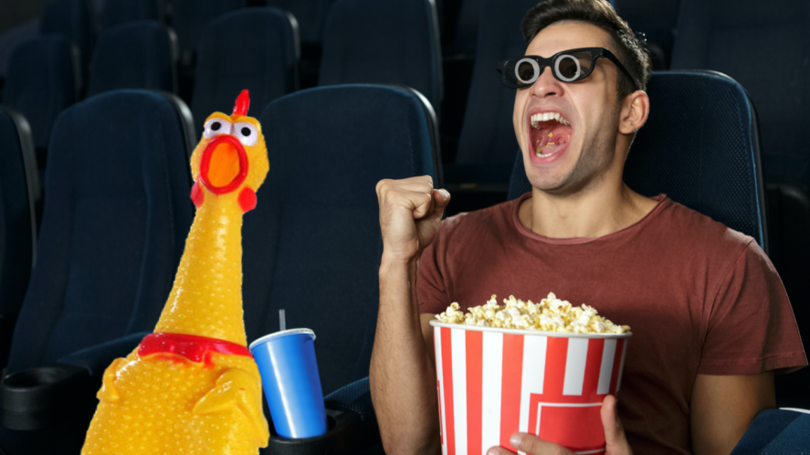 Person and rubber chicken at the movies