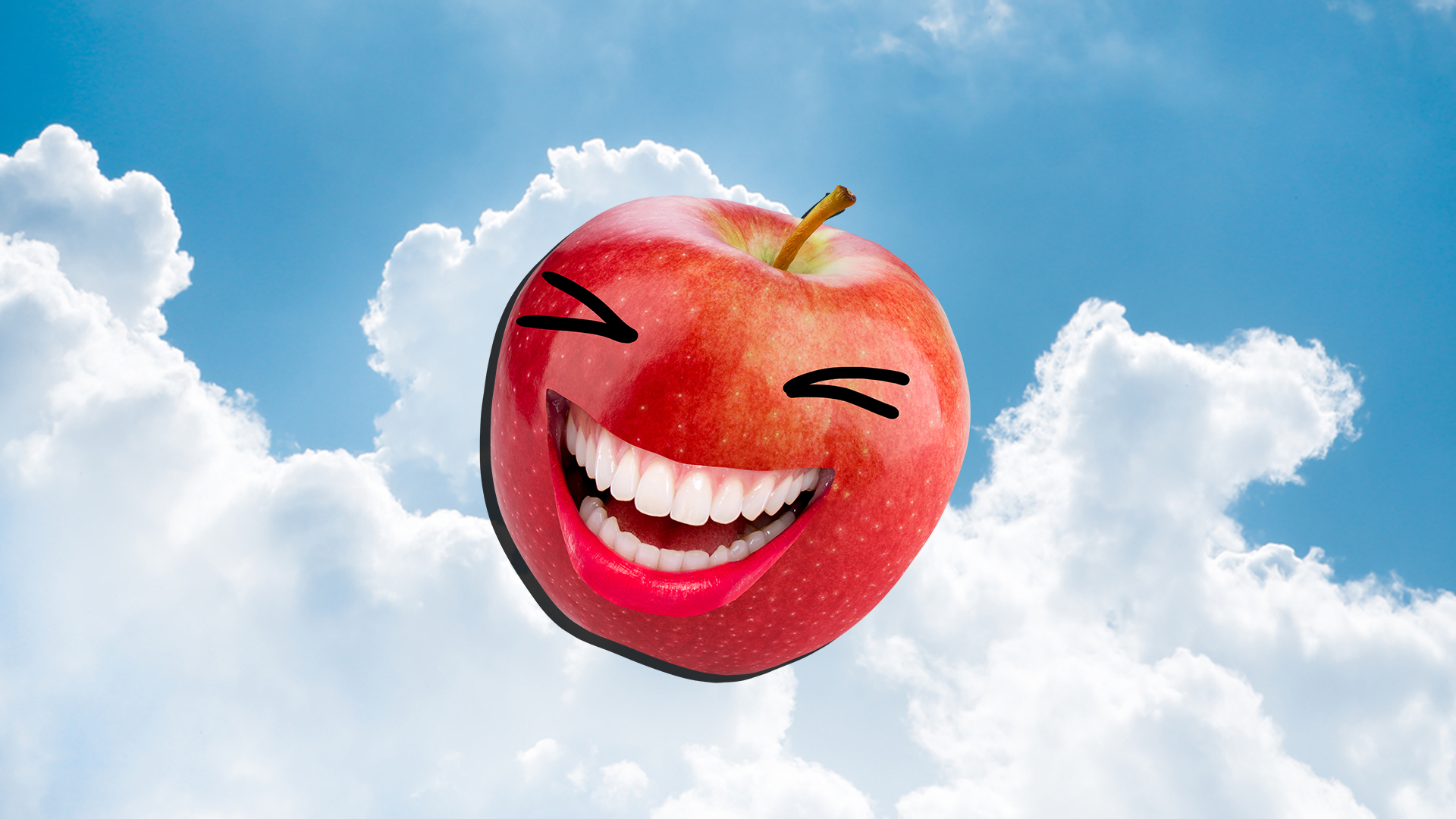 A laughing red apple in front of a cloudy and blue sky background