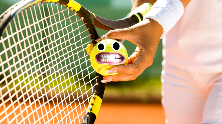 Person holding tennis ball and racket