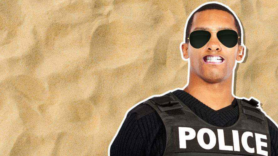 A police officer next to a sandy background