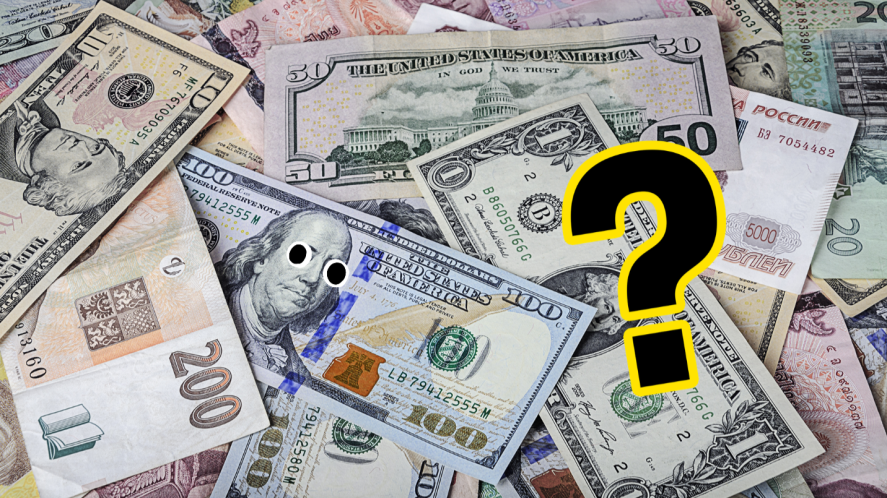 Pile of banknotes and question mark