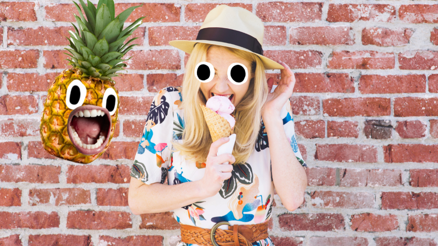 Woman eating ice cream on brick wall with pineapple