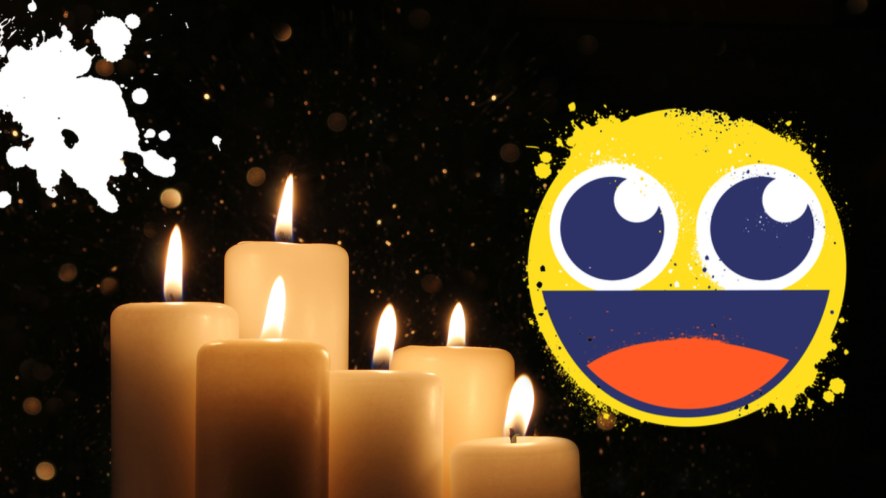 Candles and emoji on black background