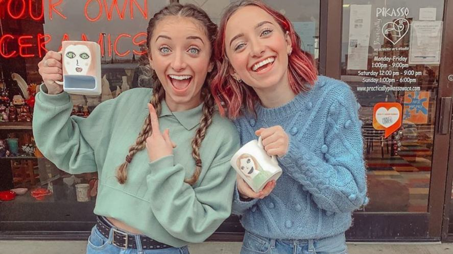 Brooklyn and Bailey holding two mugs