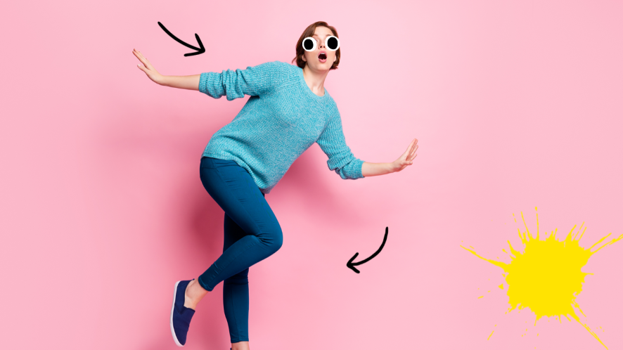 Woman tripping on pink background