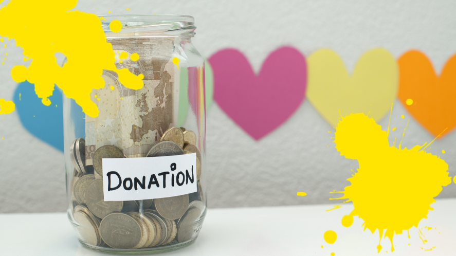 Jar of money on table with love heart background