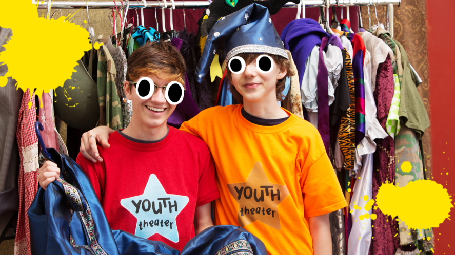 Two boys in front of clothes rail at Youth Theatre