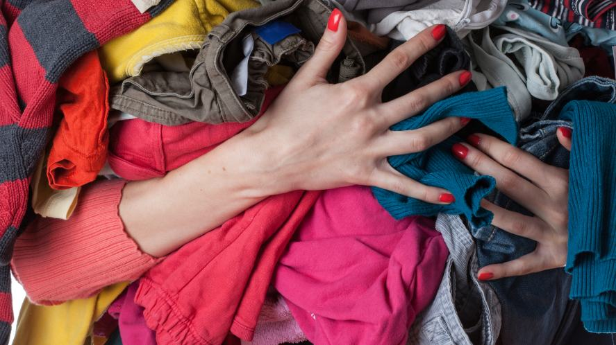 Person holding clothes