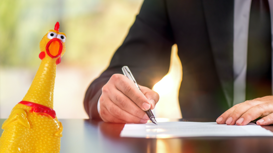 A man signing an official document