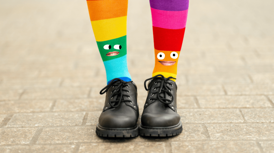 A pair of colourful socks and black shoes